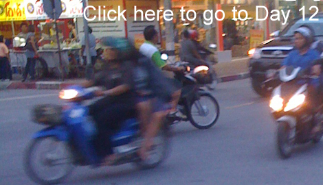 Motorbikes streaming by in Bangkok