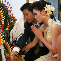 Thai Couple making Wai greeting